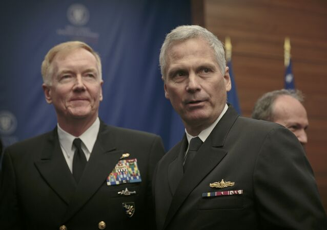 Vice Admiral James D. Syring, right, Director of the US Missile Defense Agency, and Commander of the 6th Fleet Vice Admiral James G. Foggo, left, stand at the end of a ceremony in Bucharest, Romania, Friday, Dec. 18, 2015.
