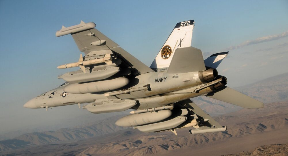An EA-18G Growler (BuNo 166856) of test and evaluation squadron VX-9 Vampires, carrying a payload of external fuel tanks and missiles