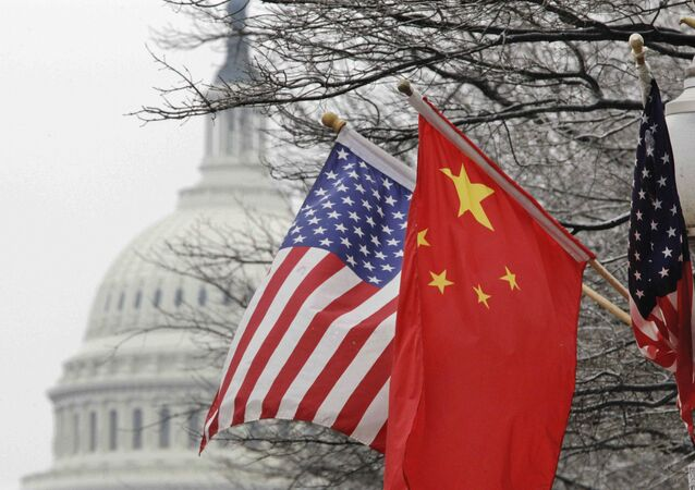 The Capitol dome is seen at rear as Chinese and U.S. flags are displayed in Washington, Tuesday, Jan. 18, 2011