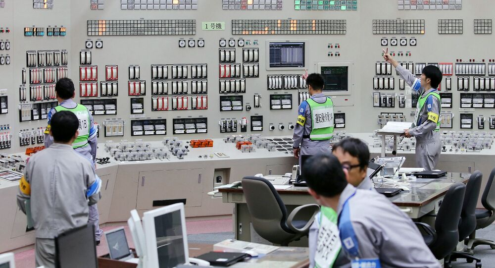 Operators restart the nuclear reactor at the central control room of the Kyushu Electric Power Sendai nuclear power plant in Satsumasendai, Kagoshima prefecture, on Japan's southern island of Kyushu on August 11, 2015