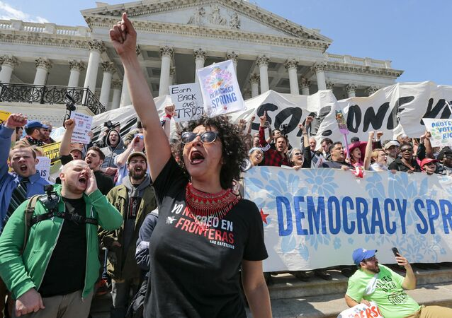 Alejandra Pablos of Arizona leads a chant as voting rights reform demonstrators stage a sit-in at the Capitol in Washington.
