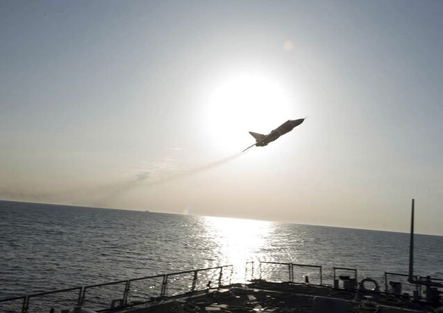 An US Navy picture shows what appears to be a Russian Sukhoi Su-24 attack aircraft flying over the US guided missile destroyer USS Donald Cook in the Baltic Sea in this picture taken April 12, 2016 and released April 13, 2016.