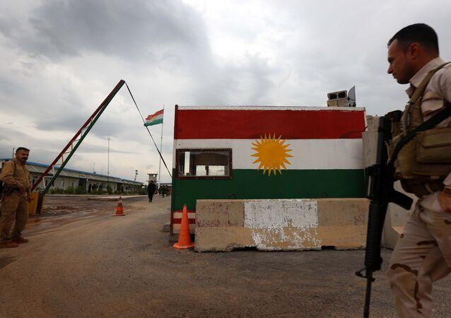 Members of the Iraqi Kurdish Peshmerga forces stand in Khazir near the Kurdish checkpoint of Aski Kalak, 40 kilometres West of Arbil, the capital of the autonomous Kurdish region of northern Iraq on April 12, 2016
