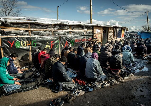 Men pray  in the migrants and refugee camp in Calais, northern France (File)