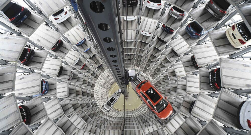 A VW Golf VII car (R) and a VW Passat are loaded in a delivery tower at the plant of German carmaker Volkswagen in Wolfsburg, Germany in this March 3, 2015