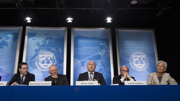French Finance Minister Michel Sapin (C) speaks next to Chancellor of the Exchequer George Osborne (L), German Finance Minister Wolfgang Schauble (2nd L), Spanish Minister of Economy and Competitiveness Luis De Guindos (2nd R) and IMF Managing Director Christine Lagarde (R) during a press conference - Sputnik International