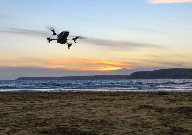 A drone overflies a beach