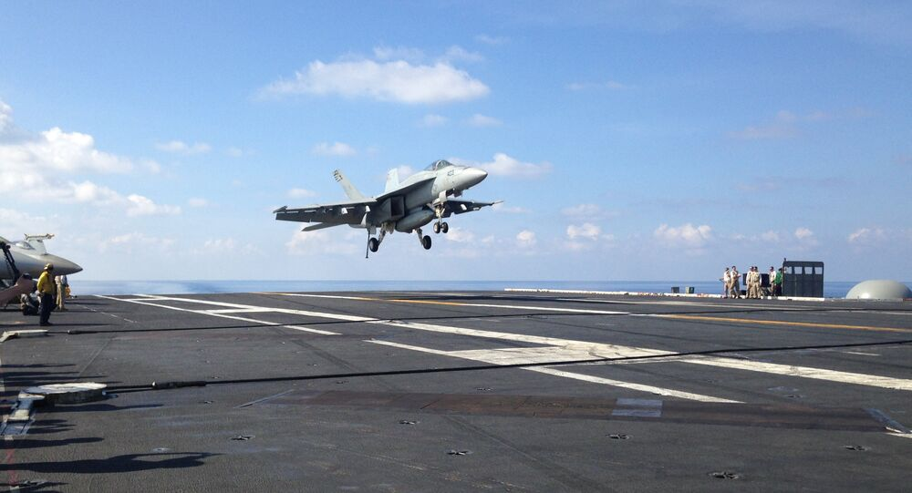 F-18 jet fighter takes off on the USS John C. Stennis, aircraft carrier in the South China Sea on Friday, April 15, 2016. U.S. Defense Secretary Ash Carter visited the aircraft carrier during a trip to the region