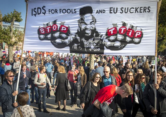 People rally against the Transatlantic Trade and Investment Partnership (TTIP), a massive free-trade accord being negotiated by the European Union and the United States, on October 10, 2015 in Amsterdam.