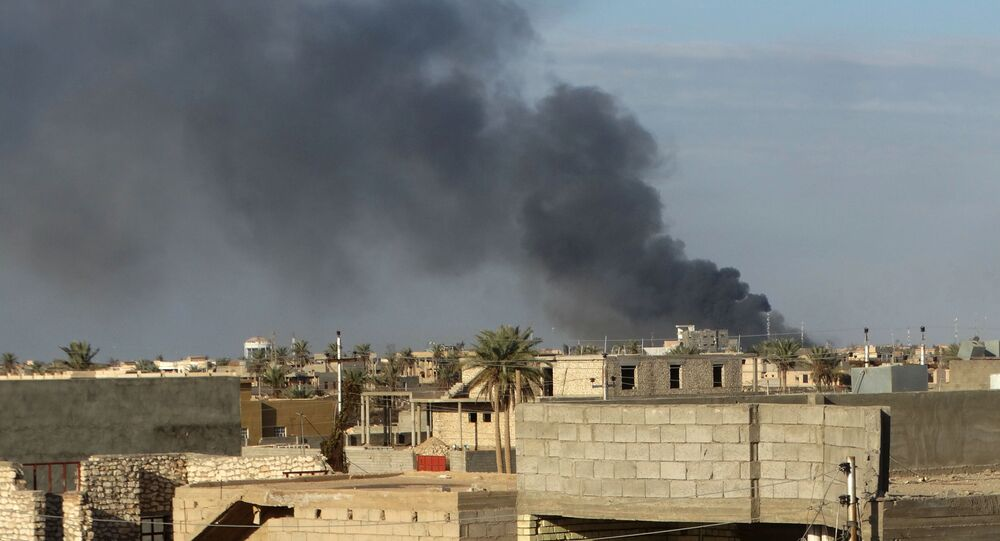 In this Monday, Jan. 4, 2016 photo, smoke rises from Islamic State positions following a U.S.-led coalition airstrike in Ramadi, 70 miles (115 kilometers) west of Baghdad, Iraq