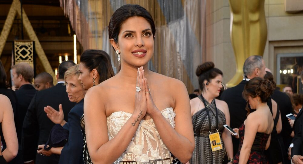 Actress Priyanka Chopra arrives on the red carpet for the 88th Oscars on February 28, 2016 in Hollywood, California