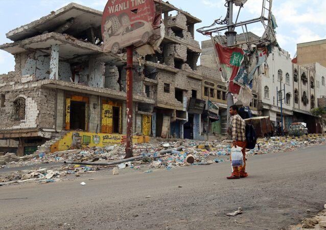 Heavily damaged buildings on a street in Yemen's third city Taez.