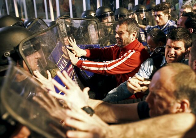 Protestors clash with policemen in front of ruling party VMRO headquarters in Skopje, Macedonia April 12, 2016.