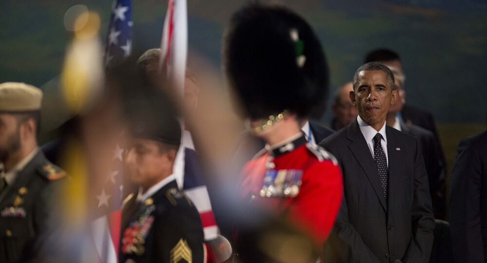 U.S. President Barack Obama watches as a British military flag bearer walks away (File)