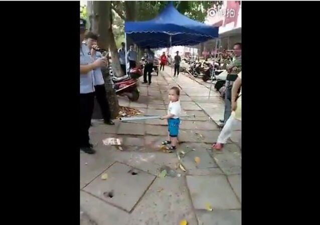 Toddler picked up steel pipe to defend his grandma from China's urban management force
