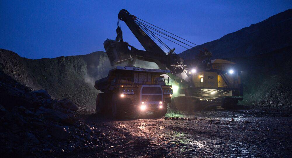 Mining coal at Bachatsky coal strip mine