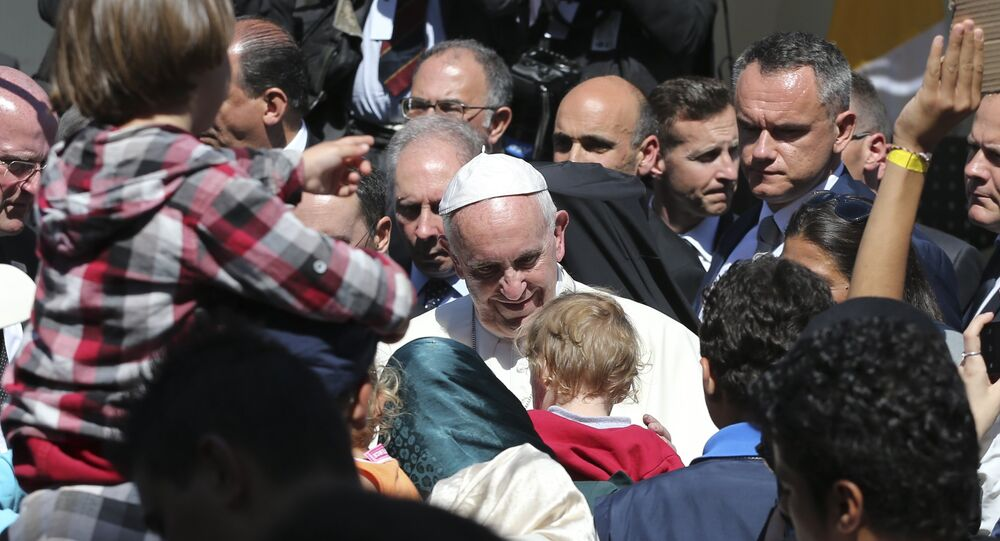 Pope Francis meets migrants at the Moria refugee camp on the Greek island of Lesbos, Saturday April 16, 2016