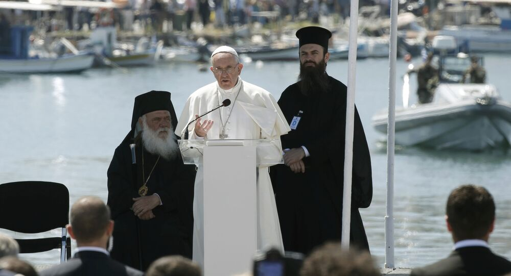 Pope Francis delivers his address at the port of Lesbos during his visits the Greek Island of Lesbos, Greece, April 16, 2016