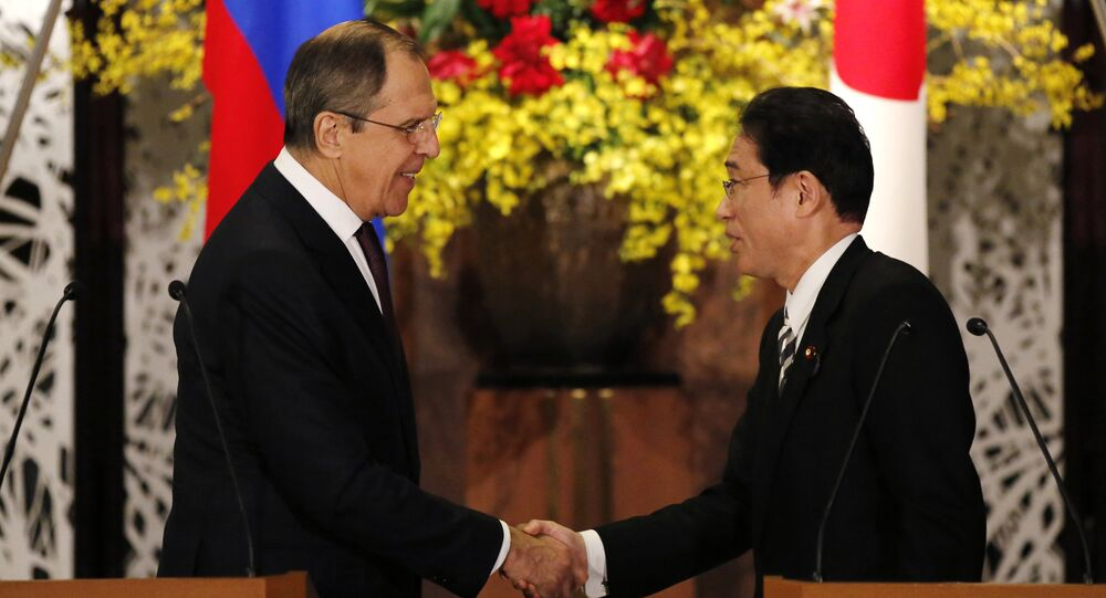 Russia's Foreign Minister Sergey Lavrov, left, shakes hands with his Japanese counterpart Fumio Kishida at the end of their joint news conference after their meeting at the foreign ministry's Iikura guest house in Tokyo, Japan, Friday, April 15, 2016