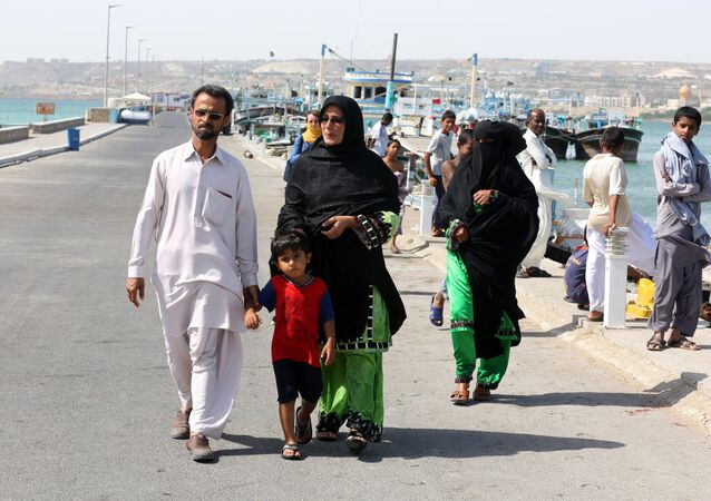 An Iranian family walks in southern port city of Chabahar (File)