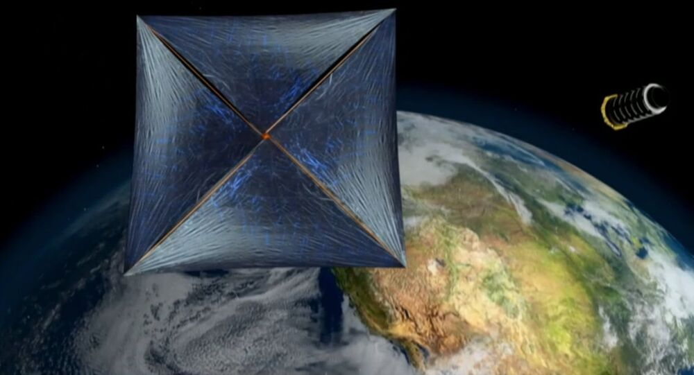This artist's illustration shows a sail-equipped nanocraft that Breakthrough Starshot team members hope to send to other star systems