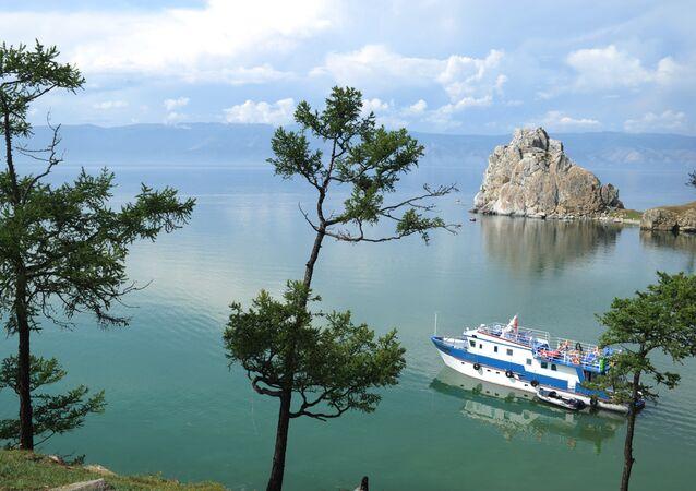 Ship sailing on Lake Baikal near Olkhon island.