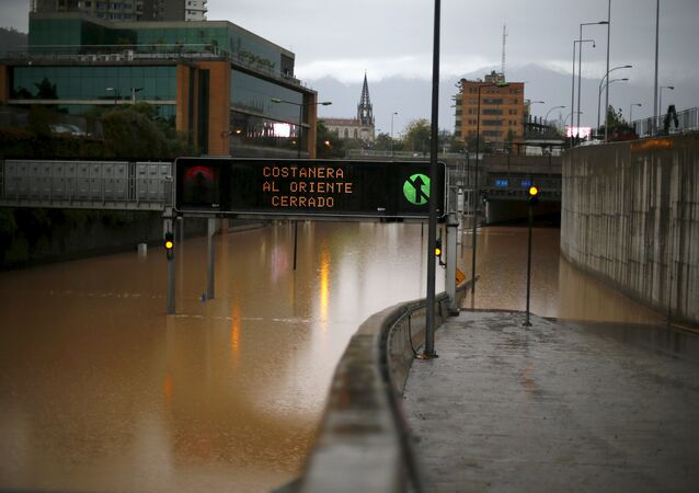 A view of a flooded highway access in Santiago April 17, 2016. The sign reads Costanera highway closed to east.