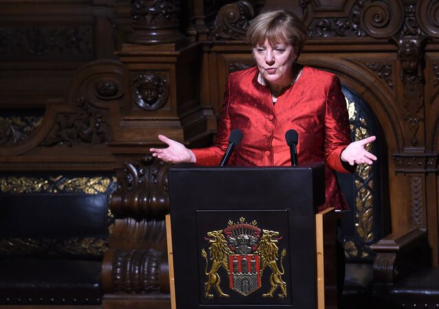 German Chancellor Angela Merkel speaks during the Matthiae Dinner attended by British Prime Minister David Cameron in Hamburg, northern Germany on February 12, 2016.