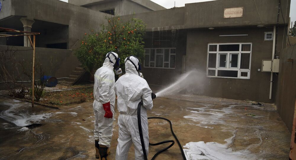 Firefighters clean houses exposed to a chemical attack in Taza, 10 miles (20 kilometers) south of Kirkuk in northern Iraq