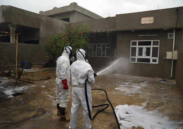 Firefighters clean houses exposed to a chemical attack in Iraq