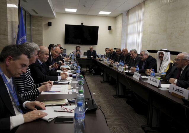 Ramzy Ezzeldin Ramzy, Deputy Special Envoy for Syria (4th L), during the Internal Syrian opposition delegation meeting, in Geneva, Switzerland on April 19, 2015.