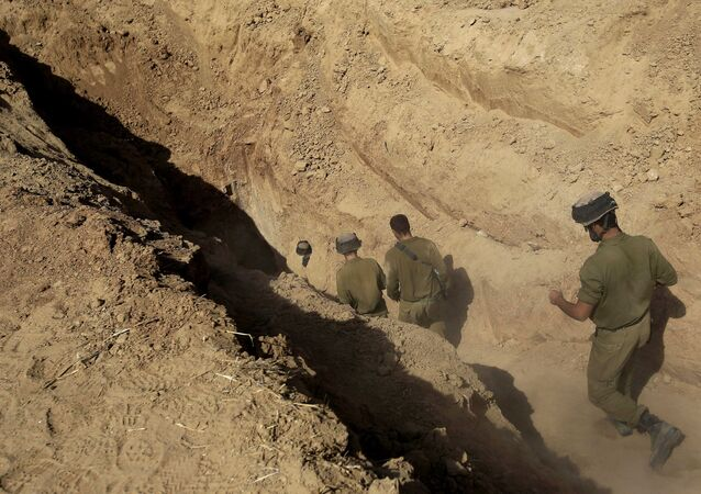 Israeli soldiers enter a tunnel discovered near the Israel Gaza border.