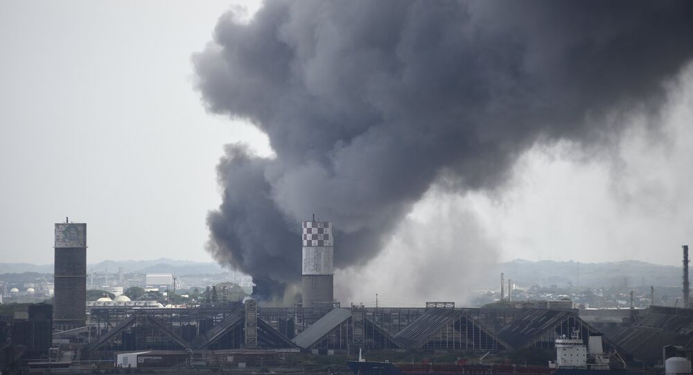 Smoke rises from the explosion site at Mexican national oil company Pemex's Pajaritos petrochemical complex in Coatzacoalcos.