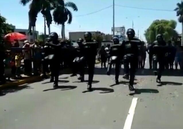 Impressive moment riot police break into DANCE in the street