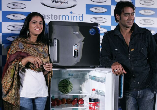 Indian Bollywood film actors and Whirlpool brand ambassadors Kajol (L) and Ajay Devgan (R) pose for a photograph during the launch of Whirlpool products in New Delhi. (File)