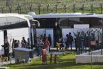 Turkish security members surround migrants after their arrival in Pehlivankoy, Kirklareli, Turkey (File)