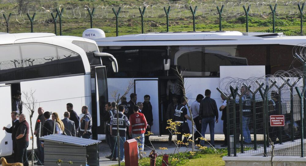 Turkish security members surround migrants after their arrival in Pehlivankoy, Kirklareli, Turkey (File)