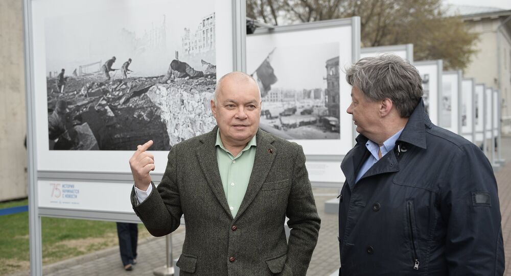 Dmitry Kiselev, Director General of the Rossiya Segodnya International Information Agency, (left) and Alexander Shtol, head of the Integrated Photography Directorate, at the opening of photo display dedicated to the 75th anniversary of Sovinformburo (Soviet Information Bureau) in Zubovsky Boulevard in Moscow