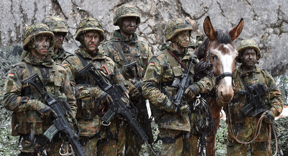 Mountain infantry soldiers, pictured after an exercise of the mountain infantry brigade 23 of the German Bundeswehr at an exercise area near the Bavarian village Bad Reichenhall, southern Germany, on March 23, 2016