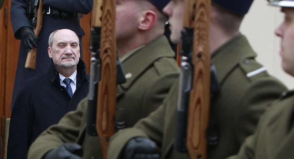 Poland's Defense Minister Antoni Macierewicz attends a meeting with his Latvian counterpart, Raimonds Bergmanis, in Warsaw, Poland, Monday, March 14, 2016