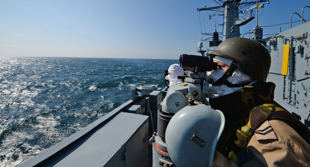 Romanian frigate Regina Maria personnel with the NATO Standing Maritime Group-2 keep watch during a military drill on the Black Sea, 60km from Constanta city March 16, 2015