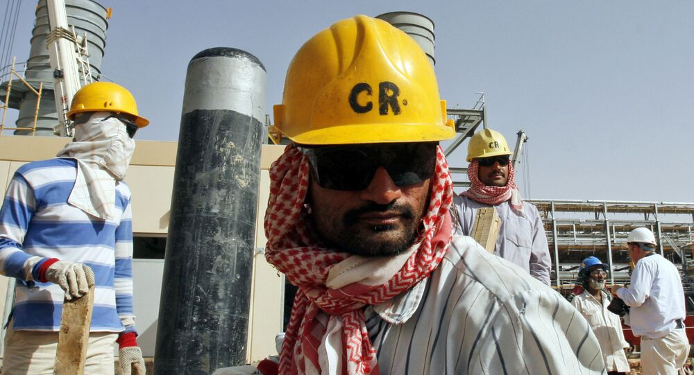 Oil workers are seen at the Khurais oil facility in an area where operations are being expanded, about 60 miles southeast of Riyadh, Saudi Arabia (File)
