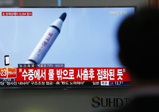 A man watches a TV news program showing a file footage of a missile launch conducted by North Korea, at the Seoul Train Station in Seoul, South Korea, Saturday, April 23, 2016