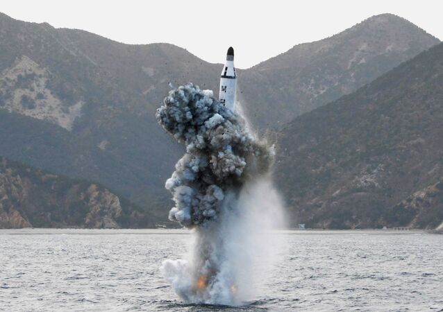 North Korean leader Kim Jong Un guides on the spot the underwater test-fire of strategic submarine ballistic missile in this undated photo released by North Korea's Korean Central News Agency (KCNA) in Pyongyang on April 24, 2016