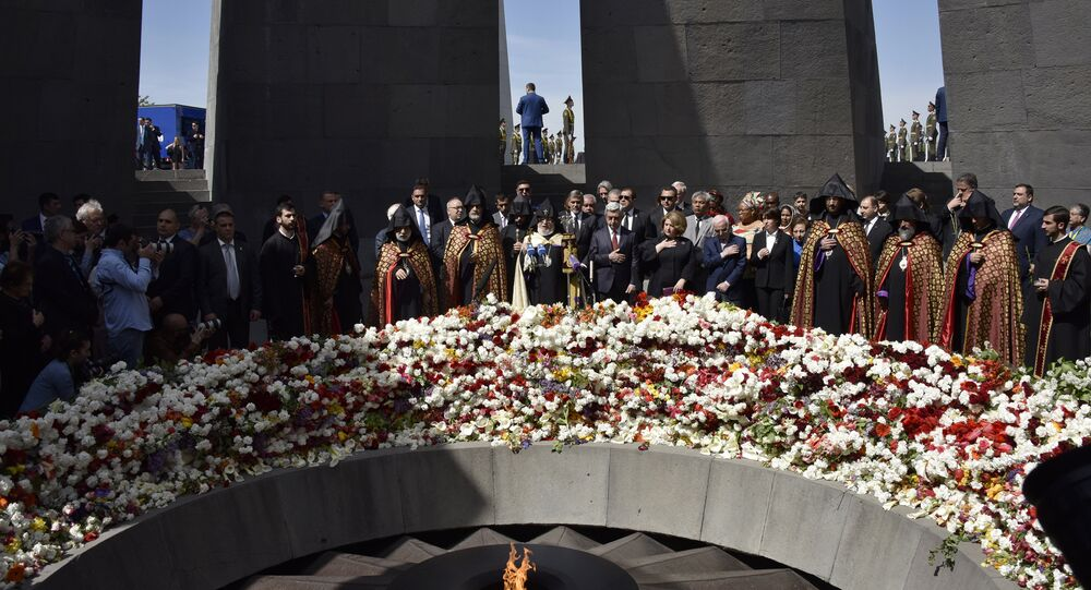 Armenian President Serzh Sarkisian (C,R) and US actor George Clooney (C) attend a ceremony at the Genocide Memorial in Yerevan on April 24, 2016