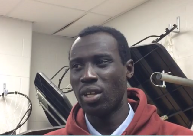 A screenshot of Jonathan Nicola from a video interview by the Windsor Star in which the talks about how he migrated to Canada as a refugee and started playing basketball at Windsor-Essex High School