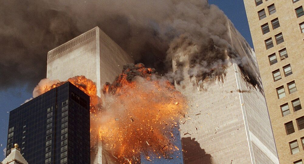 Smoke billows from one of the towers of the World Trade Center and flames and debris explode from the second tower, Tuesday, Sept. 11, 2001