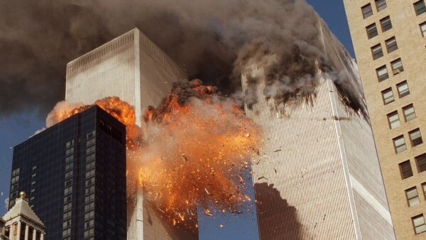 Smoke billows from one of the towers of the World Trade Center and flames and debris explode from the second tower, Tuesday, Sept. 11, 2001 - Sputnik International