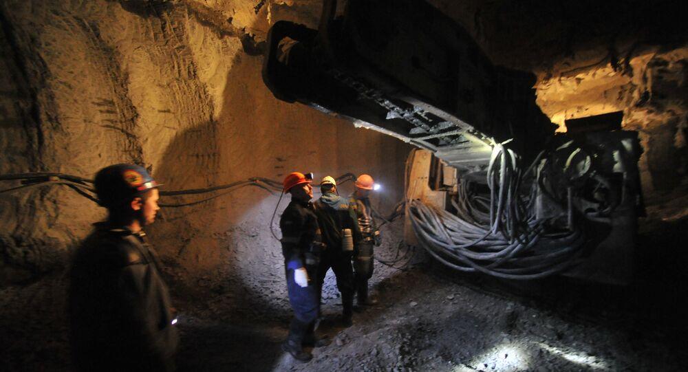 Extracting diamond-bearing kimberlite ore at ALROSA's Internatsionalny diamond field in Mirny, Republic of Sakha (Yakutia)