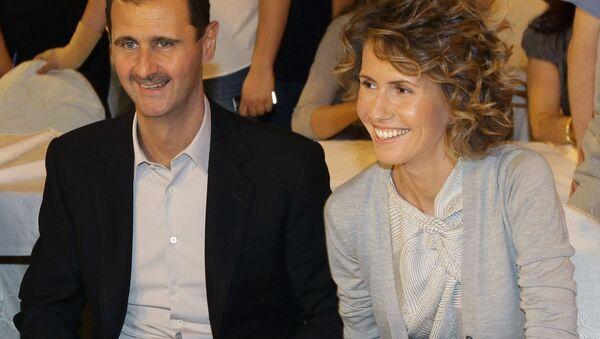 Syrian President Bashar Assad and his wife Asma. file photo - Sputnik International